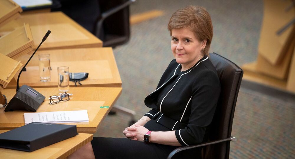 Scotland's First Minister Nicola Sturgeon sits at the main chamber ahead of a coronavirus disease (COVID-19) briefing at the Scottish Parliament in Holyrood, Edinburgh, Scotland, Britain March 23, 2021.