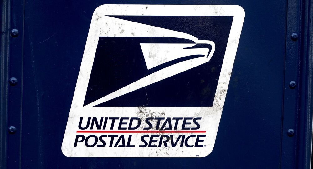 FILE PHOTO: The U.S. Postal Service (USPS) logo is pictured on a mail box in the Manhattan borough of New York City, New York, U.S., August 21, 2020. REUTERS/Carlo Allegri/File Photo