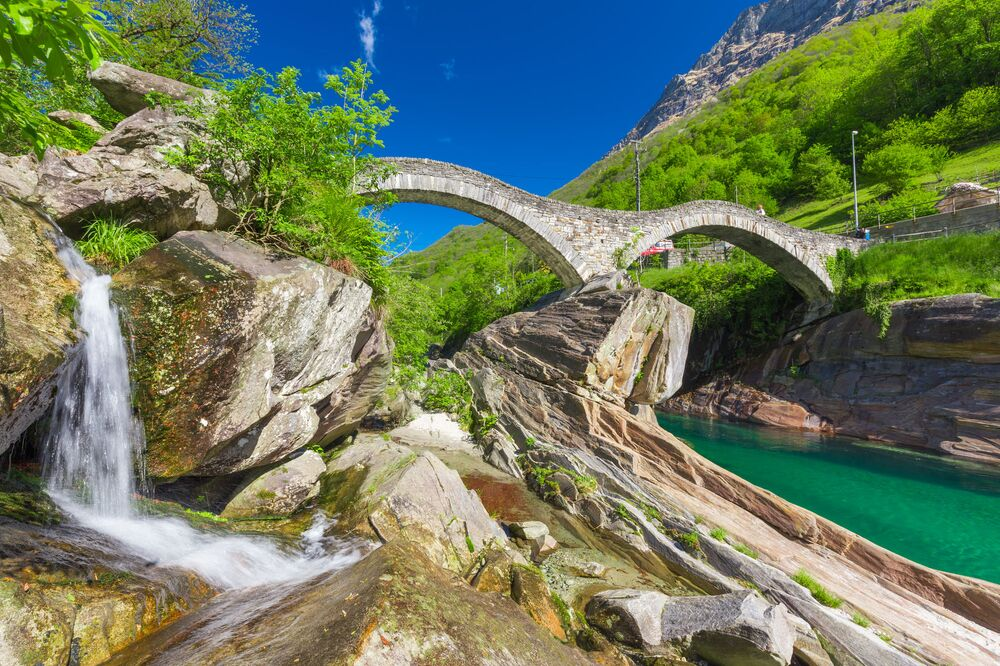 Double arch stone bridge at Ponte dei Salti with waterfall, Lavertezzo, Verzascatal, Canton Tessin, Switzerland.