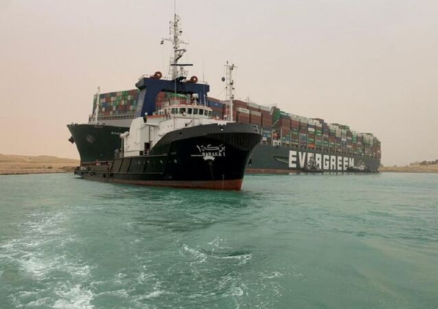 A container ship which was hit by strong wind and ran aground is pictured in Suez Canal, Egypt March 24, 202