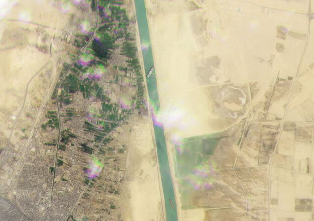 Planet Labs Inc satellite image shows the Ever Given, a container ship operated by the Evergreen Marine Corporation, stranded in the Suez Canal, Egypt March 23, 2021.