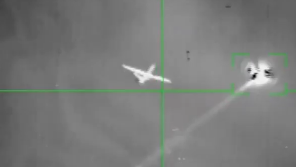 A UAV purported to be a US MQ-9 Reaper fires a projectile before being hit by a Houthi anti-air missile. It's unclear whether the drone fired its own weapon or a defensive flare. - Sputnik International