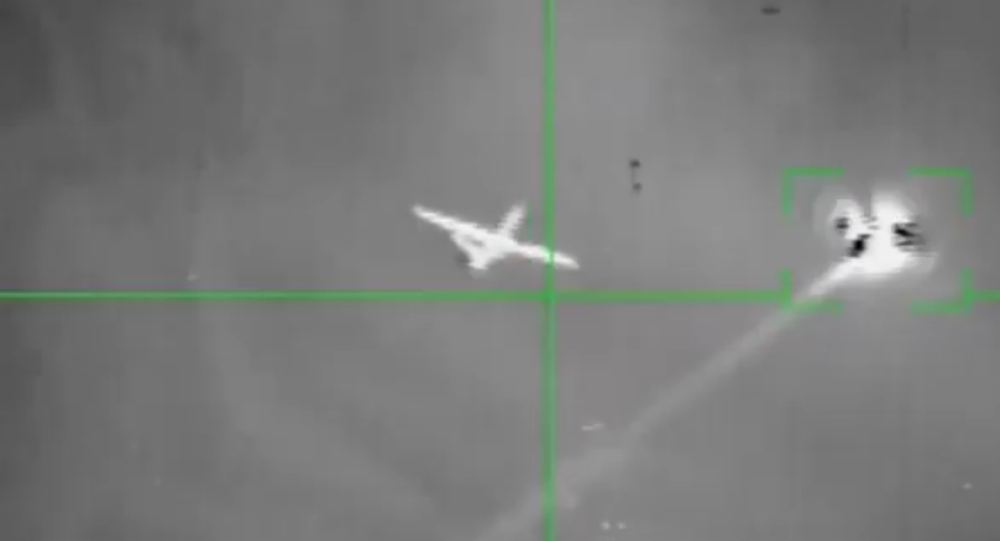 A UAV purported to be a US MQ-9 Reaper fires a projectile before being hit by a Houthi anti-air missile. It's unclear whether the drone fired its own weapon or a defensive flare.