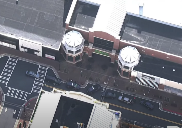 Helicopter footage from 11Alive shows the scene outside an area Publix grocery store on March 24, 2021