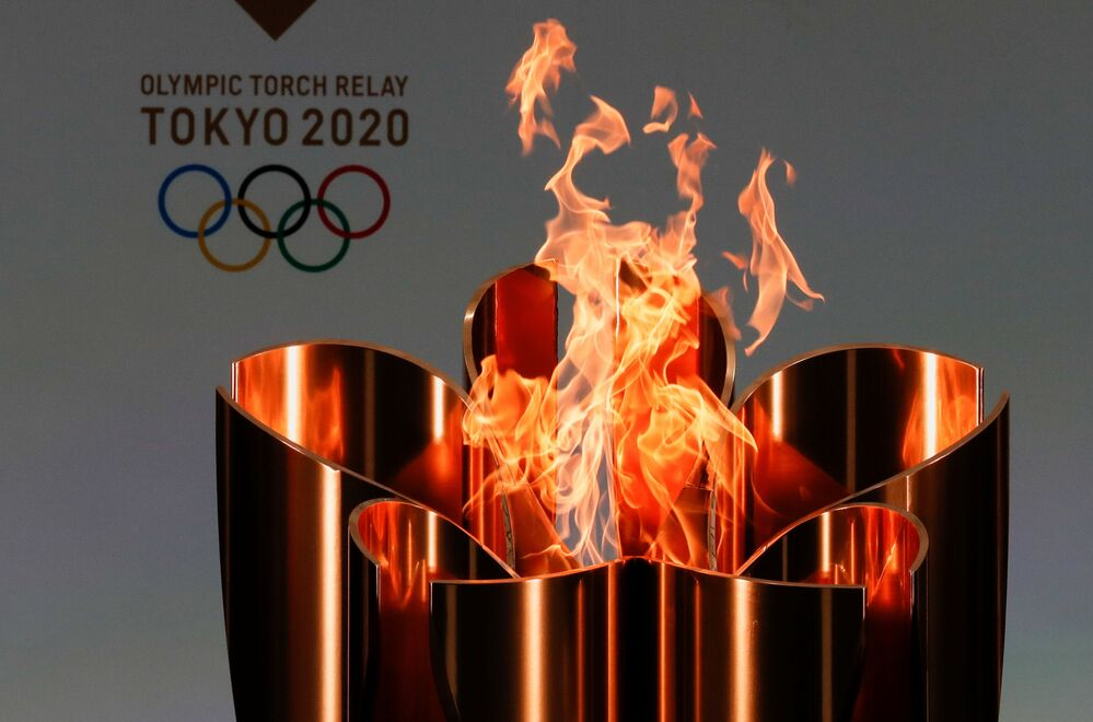 The celebration cauldron is lit on the first day of the Tokyo 2020 Olympic torch relay in Naraha, Fukushima prefecture, Japan, 25 March 2021.