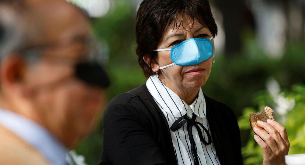 Ana Maria Gonzalez wears a new innovation, a nasal mask designed by Mexican scientist Gustavo Acosta Altamirano, as a measure to protect against the coronavirus disease (COVID-19) transmission during the process of eating and drinking at the National Polytechnic Institute, in Mexico City, Mexico March 18, 2021