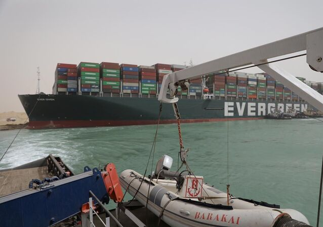 Stranded container ship Ever Given, one of the world's largest container ships, is seen after it ran aground, in Suez Canal, Egypt March 25, 2021