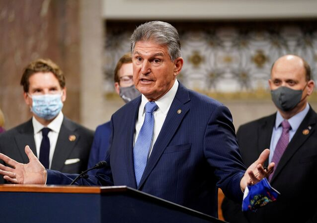 Democrat senator for West Virginia, Joe Manchin, removes his mask to speak as bipartisan members of the Senate and House gather to announce a framework for fresh coronavirus disease (COVID-19) relief legislation at a news conference on Capitol Hill in Washington, US, 1 December 2020.
