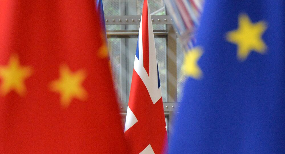 European Union and Chinese flags are pictured during an annual EU-China summit in Brussels, Belgium.