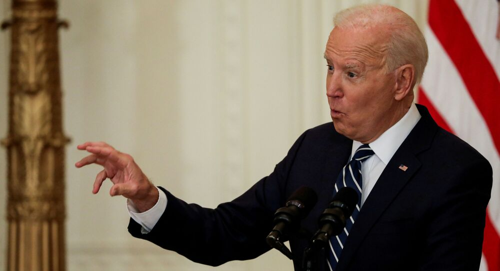 U.S. President Joe Biden takes questions as he holds his first formal news conference in the East Room of the White House in Washington, U.S., March 25, 2021