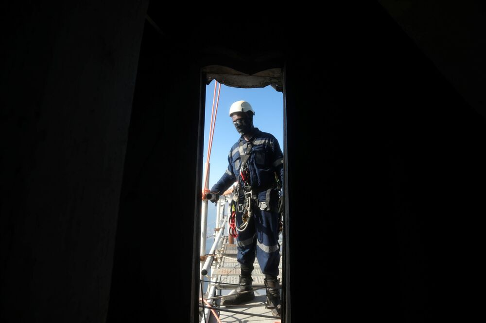 A worker prepares to climb the Christ the Redeemer statue for restoration, as work is underway ahead of its 90th anniversary, in Rio de Janeiro, Brazil, 24 March 2021.