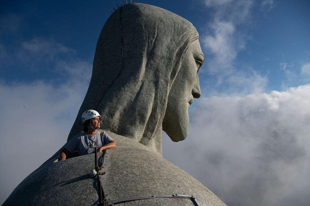 Architect Cristina Ventura, who is in charge of the Christ the Redeemer statue's restoration, looks out from the top of the Christ the Redeemer statue in Rio de Janeiro on 24 March 2020.