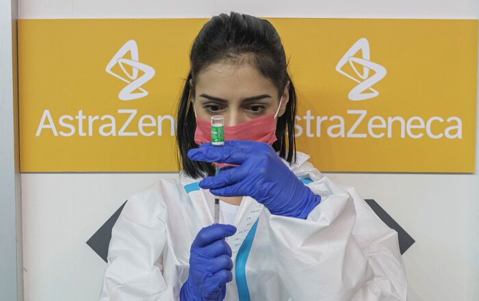 A nurse fills a syringe with a dose of the AstraZeneca vaccine against the coronavirus disease (COVID-19)