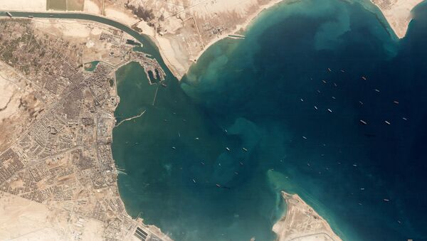 A satellite image shows the Ever Given and idling ships at the entrance of the Suez Canal, Egypt March 25, 2021. Planet Labs Inc./Handout via REUTERS - Sputnik International
