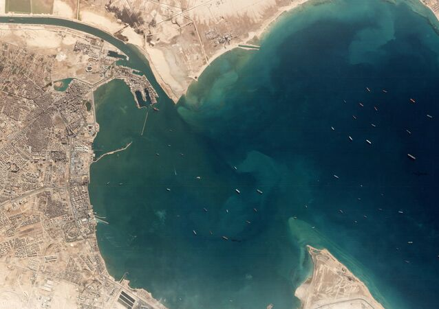 A satellite image shows the Ever Given and idling ships at the entrance of the Suez Canal, Egypt March 25, 2021. Planet Labs Inc./Handout via REUTERS