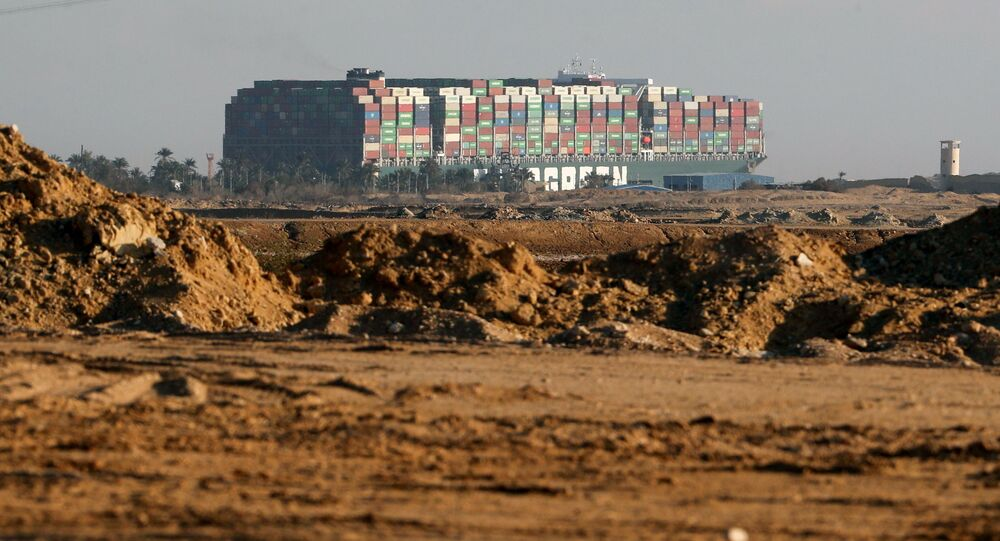Stranded container ship Ever Given, one of the world's largest container ships, is seen after it ran aground, in Suez Canal, Egypt March 26, 2021