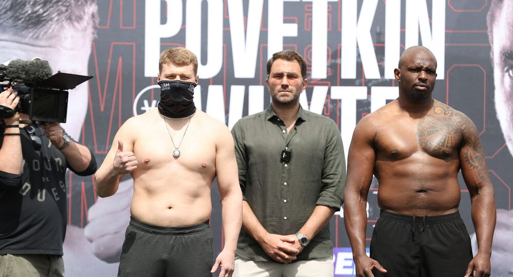 Alexander Povetkin (left) and Dillian Whyte flank boxing promoter Eddie Hearn in Gibraltar