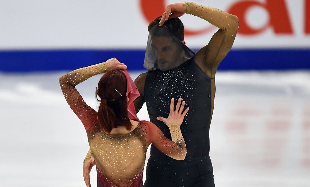 Nicole Della Monica and Matteo Guarise of Italy perform during the Pairs Short Programme.
