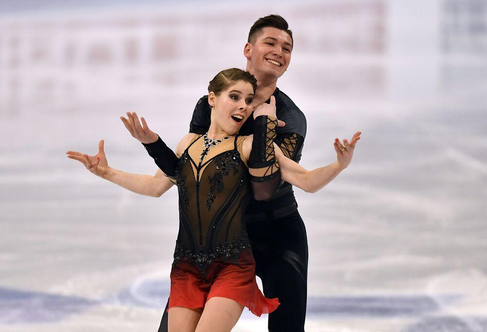Russian pair Anastasia Mishina and Aleksandr Galliamov perform during the Pairs Short Programme.
