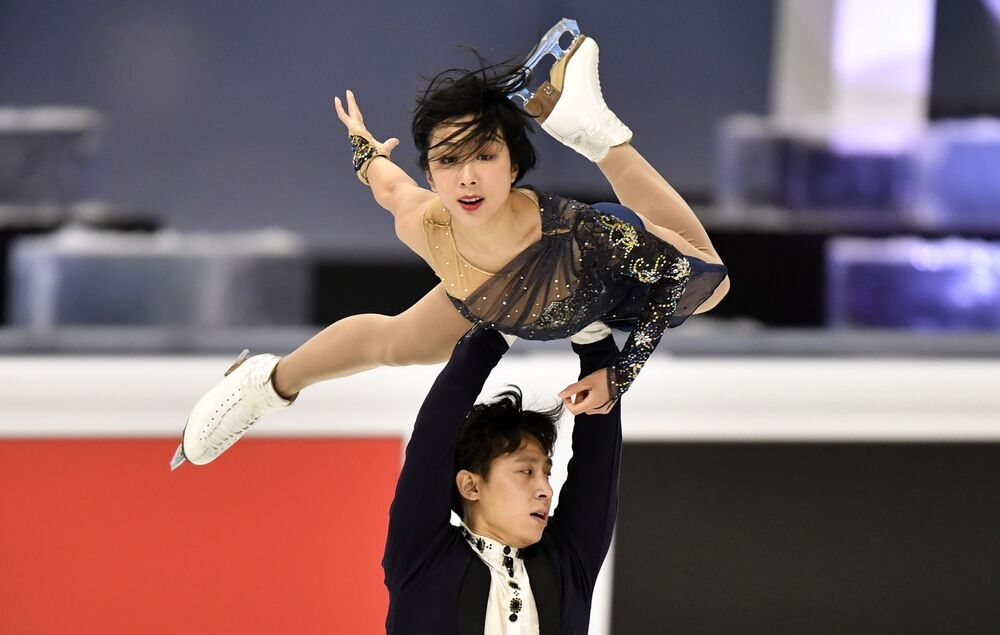 Wenjing Sui and Cong Han of China perform during the Pairs Short Programme .