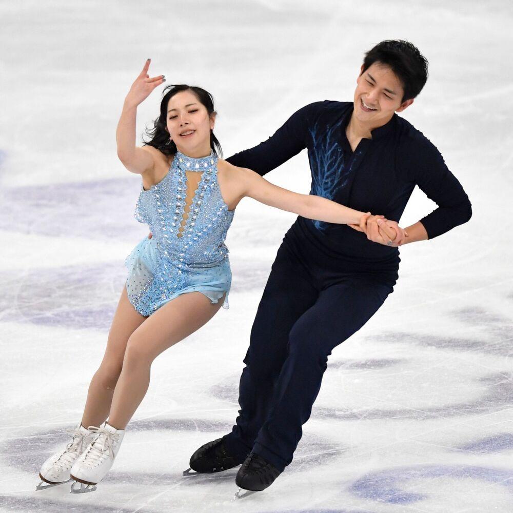 Japan's Riku Miura and Ryuichi Kihar in action during the pairs short programme.