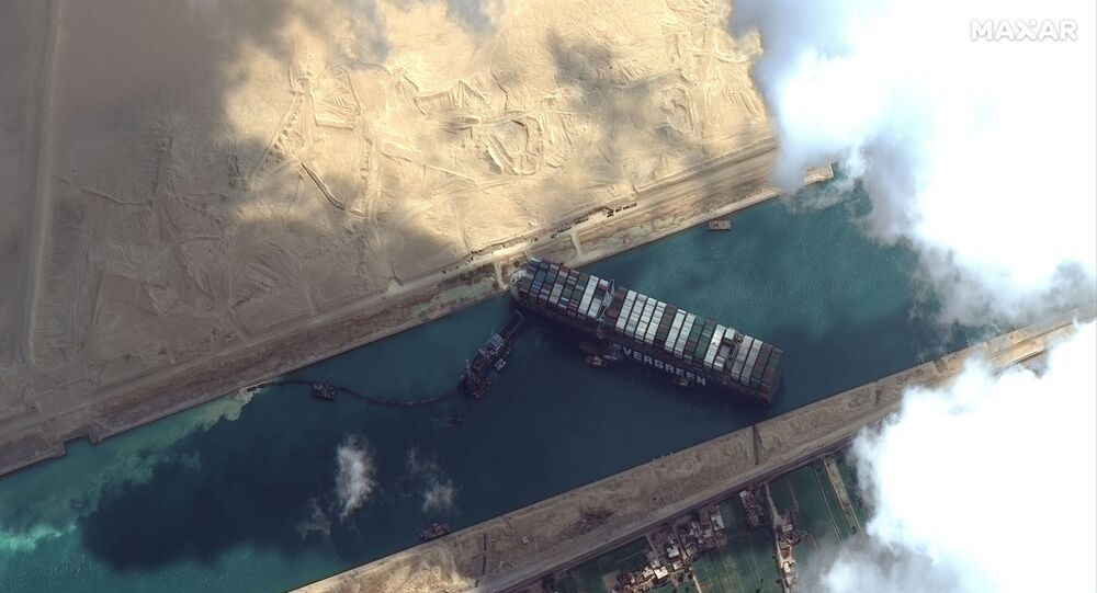 The Ever Given container ship is pictured in the Suez Canal in this Maxar Technologies satellite image, taken on 26 March 2021