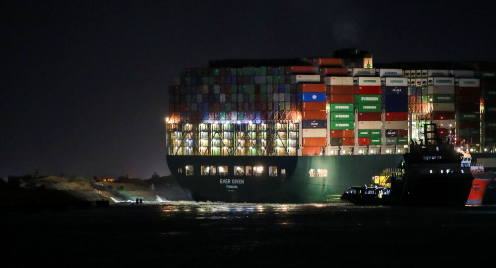 A view shows the stranded container ship Ever Given, one of the world's largest container ships, after it ran aground, in Suez Canal, Egypt March 27, 2021.