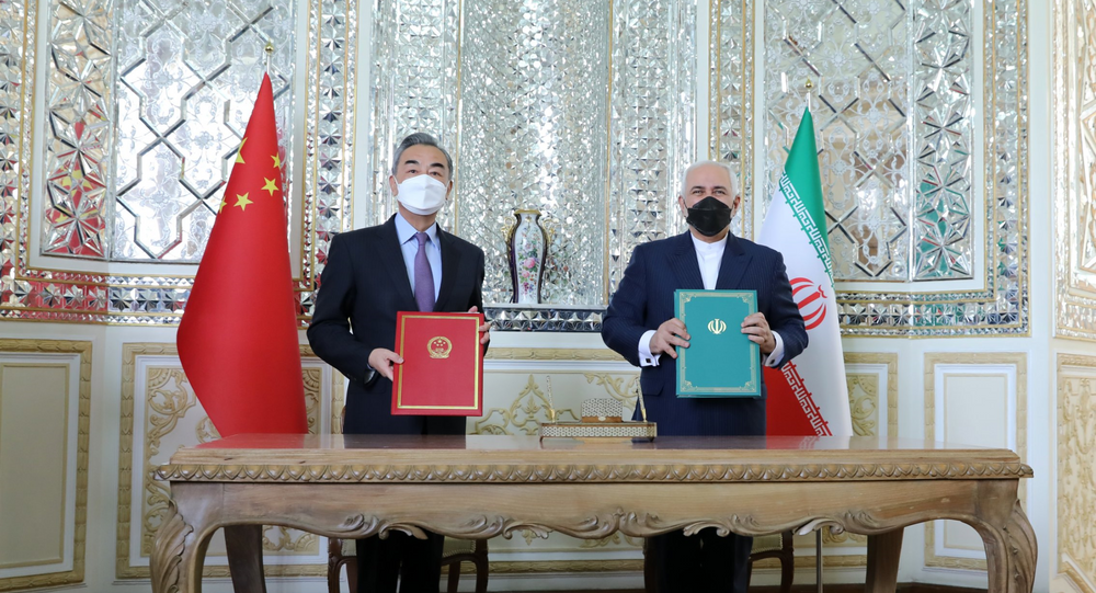 Chinese Foreign Minister Wang Yi and Iranian Foreign Minister Mohammad Javad Zarif sign 'historic' 25-year strategic partnership roadmap.