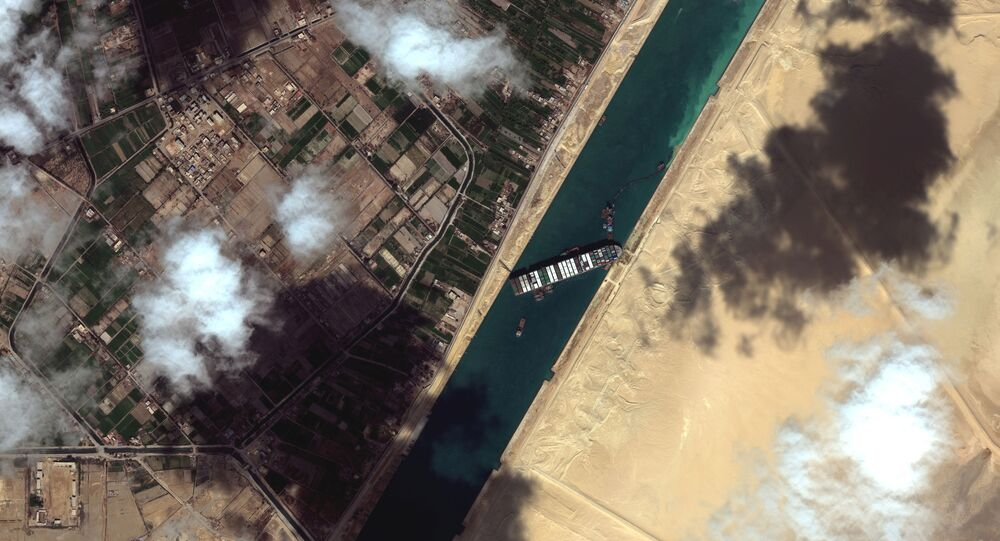 A general view of the Ever Given container ship in Suez Canal, in Suez Canal in this Maxar Technologies satellite image taken on March 27, 2021.