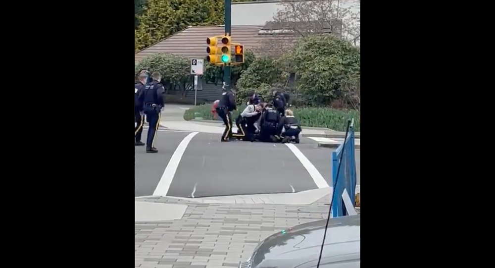 Screenshot from a video alleged to show the moment that the stabbing attack suspect was arrested by North Vancouver RCMP officers