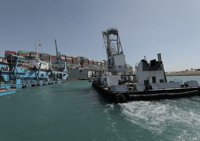 Dredgers attempt to free stranded ship Ever Given, one of the world's largest container ships, in Suez Canal, Egypt