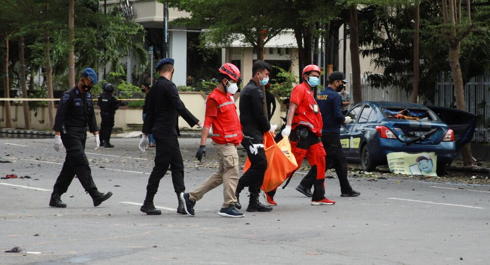 Indonesian Red Cross personnel carry a body bag following an explosion outside a Catholic church in Makassar, South Sulawesi province, Indonesia, 28 March 2021.
