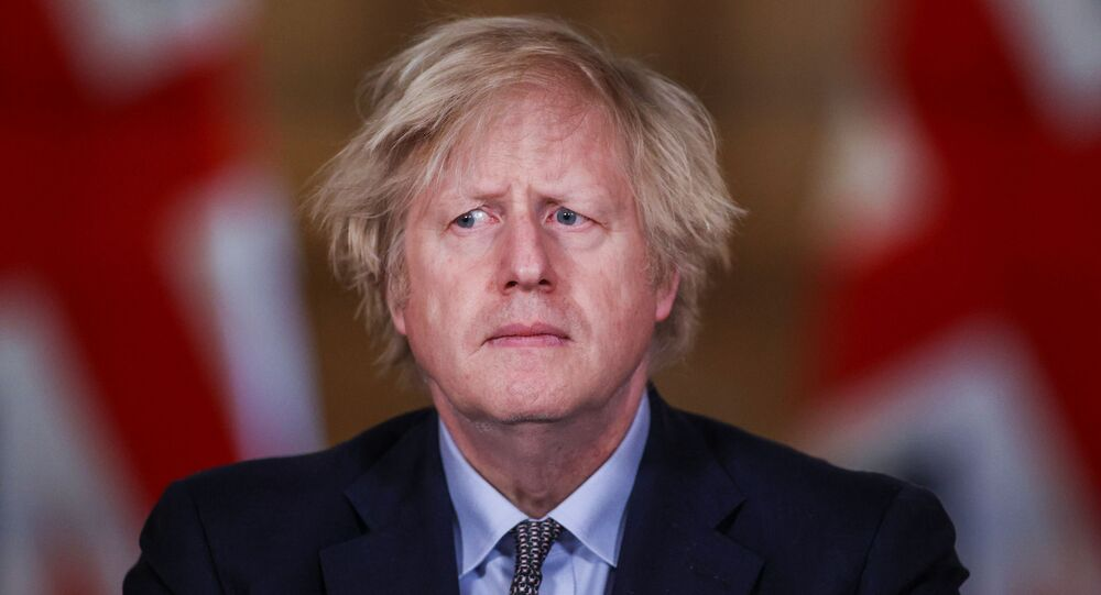 Britain's Prime Minister Boris Johnson holds a news conference at 10 Downing Street, on the day of reflection to mark the anniversary of Britain's first coronavirus disease (COVID-19) lockdown, in London, Britain March 23, 2021