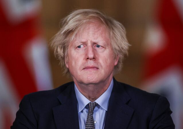 Britain's Prime Minister Boris Johnson holds a news conference at 10 Downing Street, on the day of reflection to mark the anniversary of Britain's first coronavirus disease (COVID-19) lockdown, in London, Britain 23 March 2021