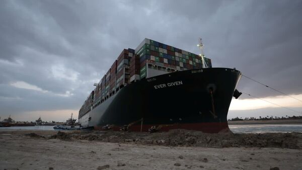 Stranded ship Ever Given, one of the world's largest container ships, is seen after it ran aground in the Suez Canal, Egypt, 28 March 2021. - Sputnik International