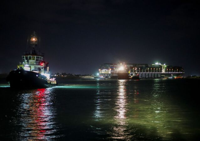 A view shows the stranded container ship Ever Given in the background, one of the world's largest container ships, after it ran aground, in Suez Canal