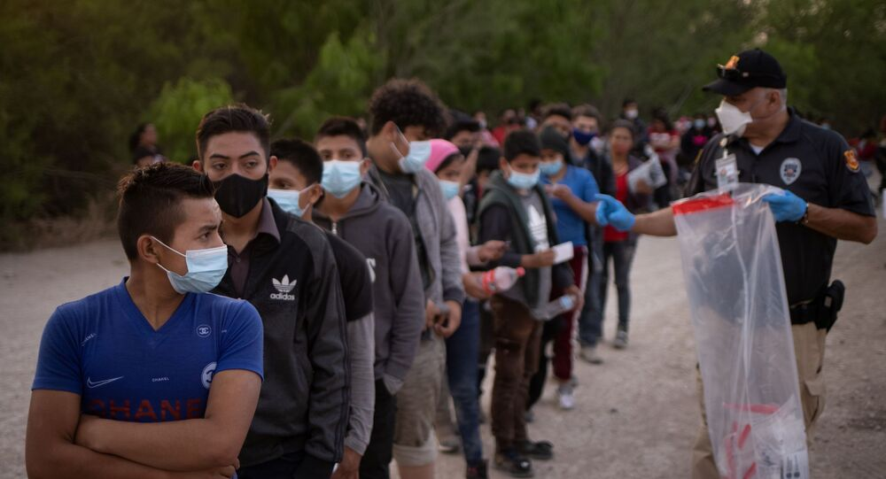 Unaccompanied minors from Central America line up to be transported by U.S. Customs Border Protection officials, after crossing the Rio Grande river into the United States from Mexico on rafts in Penitas, Texas, U.S., March 26, 2021.
