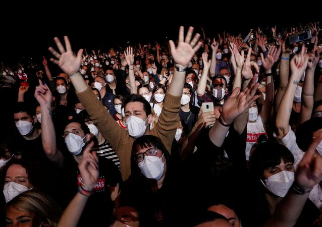 People wearing protective masks attend a concert of Love of Lesbian at the Palau Sant Jordi, the first massive concert since the beginning of the coronavirus disease (COVID-19) pandemic in Barcelona, Spain, March 27, 2021.