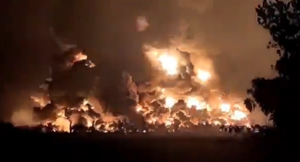 Screenshot from a video showing the moment of a massive explosion hitting Balongan oil refinery in Indramayu region, Indonesia