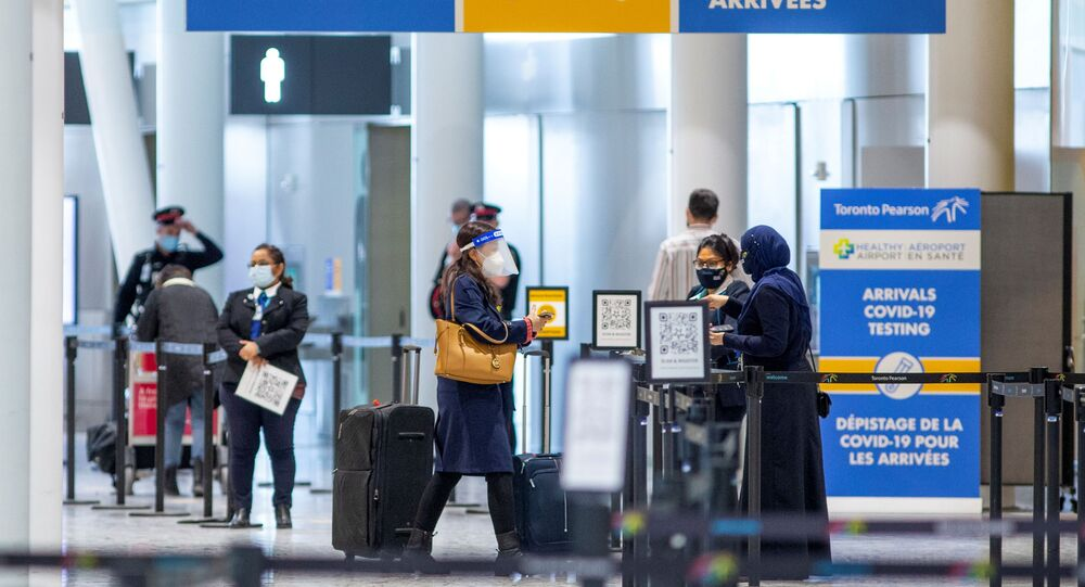 Passengers wait to be tested after they arrive at Toronto's Pearson airport after mandatory coronavirus disease (COVID-19) testing took effect for international arrivals in Mississauga, Ontario, Canada February 15, 2021