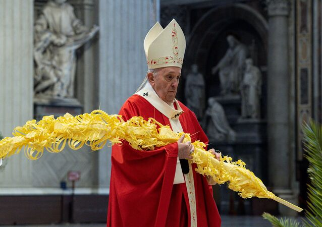 Pope Francis holds mass on Palm Sunday at the Vatican with a limited number of attendees as strict COVID-19 restrictions remain in place over the Easter period, in St. Peter's Basilica at the Vatican, 28 March 2021