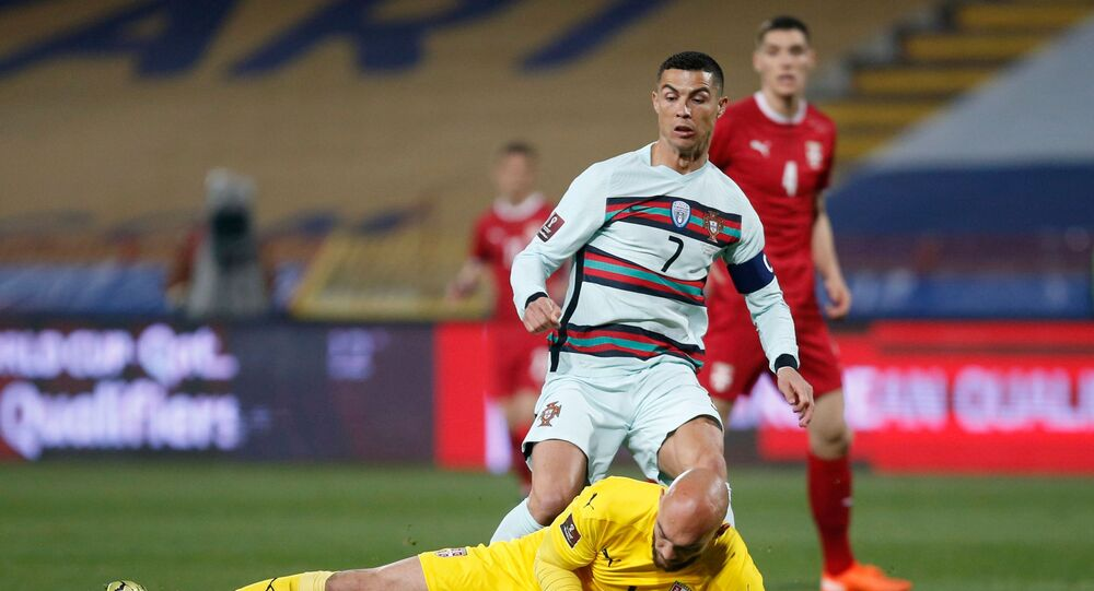 Portugal's Cristiano Ronaldo in action with Serbia's Marko Dmitrovic