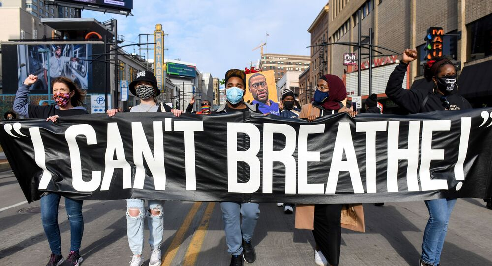 Protesters march through downtown Minneapolis during the I Can't Breathe  Silent March for Justice a day before jury selection is scheduled to begin for the trial of Derek Chauvin, the former Minneapolis policeman accused of killing George Floyd, in Minneapolis, Minnesota, U.S. March 7, 2021.