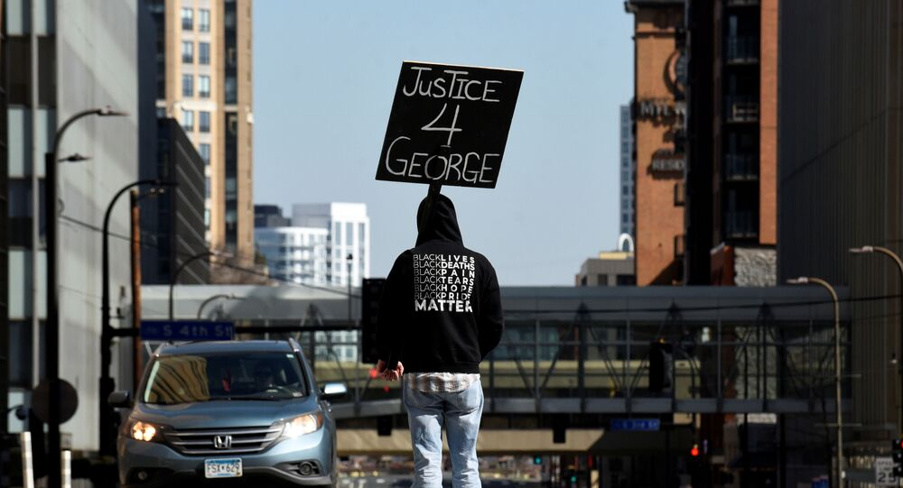 A demonstrator blocks traffic outside the Hennepin County Government Center during the first day of the trial of former police Derek Chauvin, who is facing murder charges in the death of George Floyd, in Minneapolis, Minnesota, U.S., March 29, 2021.