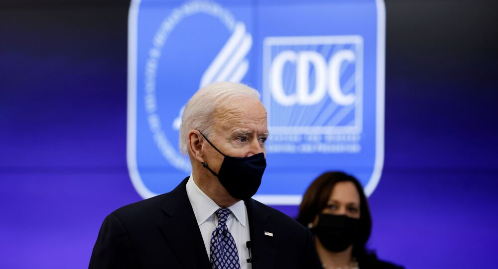 U.S. President Joe Biden and Vice President Kamala Harris receive an update on the fight against the coronavirus disease (COVID-19) pandemic as they visit the Centers for Disease Control and Prevention (CDC) in Atlanta, Georgia, U.S., March 19, 2021