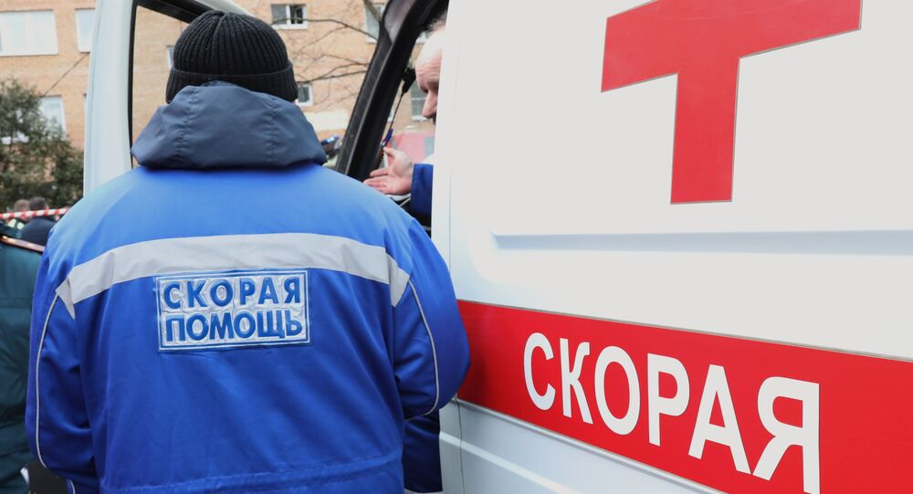 Ambulance workers at a residential building on Zelenaya Street in Khimki, damaged by an explosion.