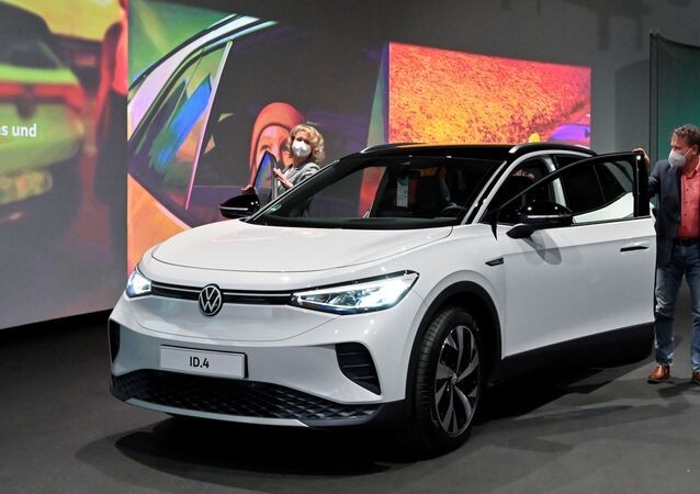 Volkswagen's new electric car ID.4 SUV is pictured during its handover by the German automaker to first customers Jaqueline Heyer-Mertens and her husband Mario Heyer at the Glaeserne Manufaktur in Dresden, Germany, March 26, 2021.