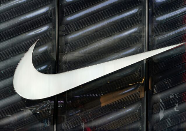 FILE PHOTO: The Nike swoosh logo is seen outside the store on 5th Ave in New York, New York, U.S., March 19, 2019.