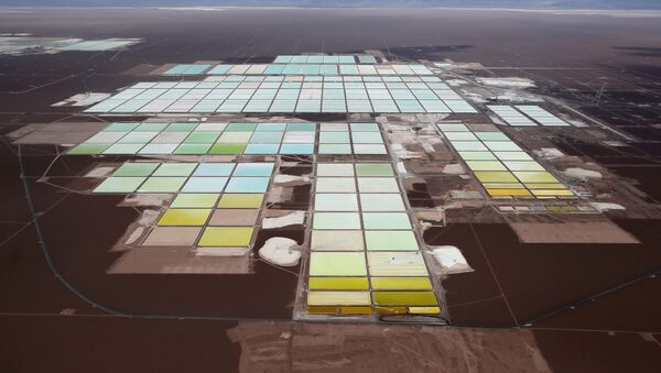 An aerial view shows the brine pools and processing areas of the Soquimich (SQM) lithium mine on the Atacama salt flat in the Atacama desert of northern Chile, January 10, 2013 - Sputnik International