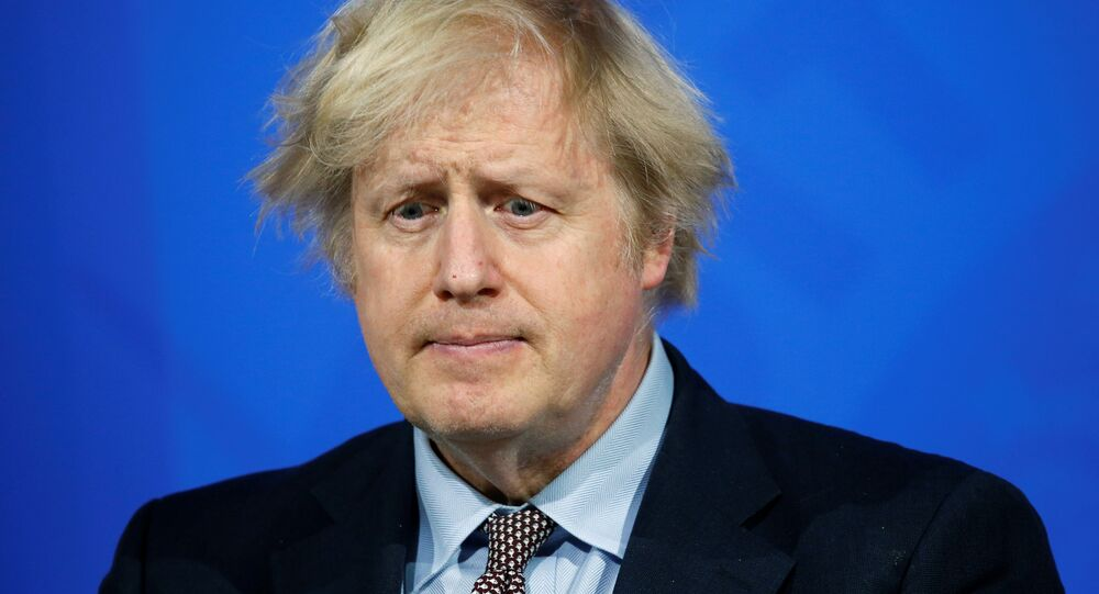 Britain's Prime Minister Boris Johnson holds a news conference on the coronavirus disease (COVID-19) pandemic, in London, Britain March 29, 2021